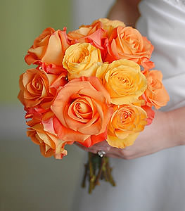 For a bride in search of vibrant colors, these traditional roses of yellow and orange are sure to make heads turn.