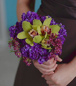 Those in search of the unconventional, eye catching yellow cymbidium orchids enclosed by bundles of vivid purple stock are sure to make heads turn.