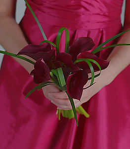 The simplicity of a small cluster of burgundy calla lilies is the perfect accent to any special day.