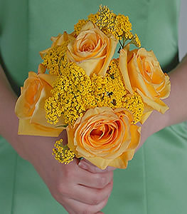 Exploding with warmth, bundles of yellow yarrow beside beautiful yellow roses ensure a bouquet not to be forgotten.