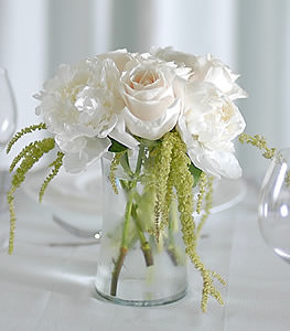 The classic white rose paired with the subtle white peonies mists an aroma of elegance to any room.