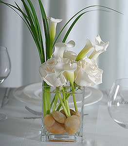 Looking for something simple? Snow white roses and white calla lilies add a pop of modern sophistication to the atmosphere.