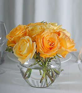 Tired of the typical red rose?  Try a bundle of creamy yellow roses sure to add an explosion of warmth to the table.