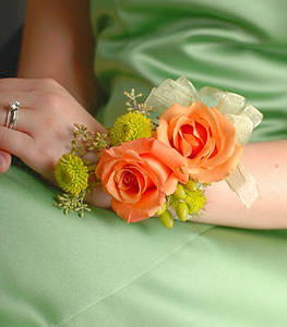 This lively and colorful pairing of orange roses with green accents is sure to draw attention.