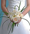 Simple yet thought provoking usage of lily grass transforms this traditional bouquet of roses and lilies into a contemporary piece fit for a modern bride.