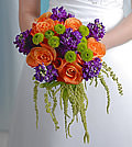 Bold contrasts of color focus attention while the well-established variety of blooms hearkens back to a classic tradition coming together in this eye-catching bouquet.