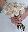 Time-honored beauty is conveyed to all by this traditional, stately bouquet of one dozen white roses.
