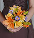 Purple asters provide a unique contrast to this fusion of sizzling orange Asiatic lilies and lively yellow roses.