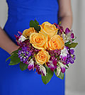 Surrounded by a purple paradise of orchids and lavender stock, alluring yellow roses present a burning touch of warmth.