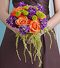 This vibrant mix of orange roses and purple stock is accented by Yoko Ono button mums; the green amaranthus adds a delicate cascade.