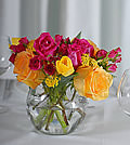 The sizzling character of this arrangement accentuates the beauty of traditional yellow and pink roses grouped with unique hot pink miniature roses. Soft clusters of yarrow balance well with yellow tulips exploding with excitement.
