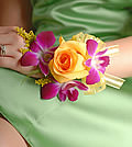 The timeless charm of a yellow rose bloom is given a contrasting tropical accent with violet orchid blooms.